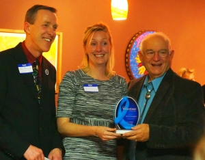 Stephen Boerigter and Kristy Ortega present Morrie Pongratz with Volunteer of the Year Award.