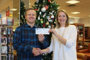 Andy Fox of CB Fox presents check to Kristy Ortega of United Way of NNM. photo credit Arin McKenna